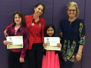 T.C. Cherry Elementary Students Sabbath Hoehn and Gabbie Robles are recognized by Katie Frassinelli of the Corvette Museum and Teacher Jenny Huskey.