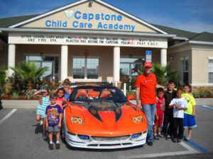 TJ Kmetz with his 2000 Extreme Corvette, sharing it with the kids at the day care he works for.